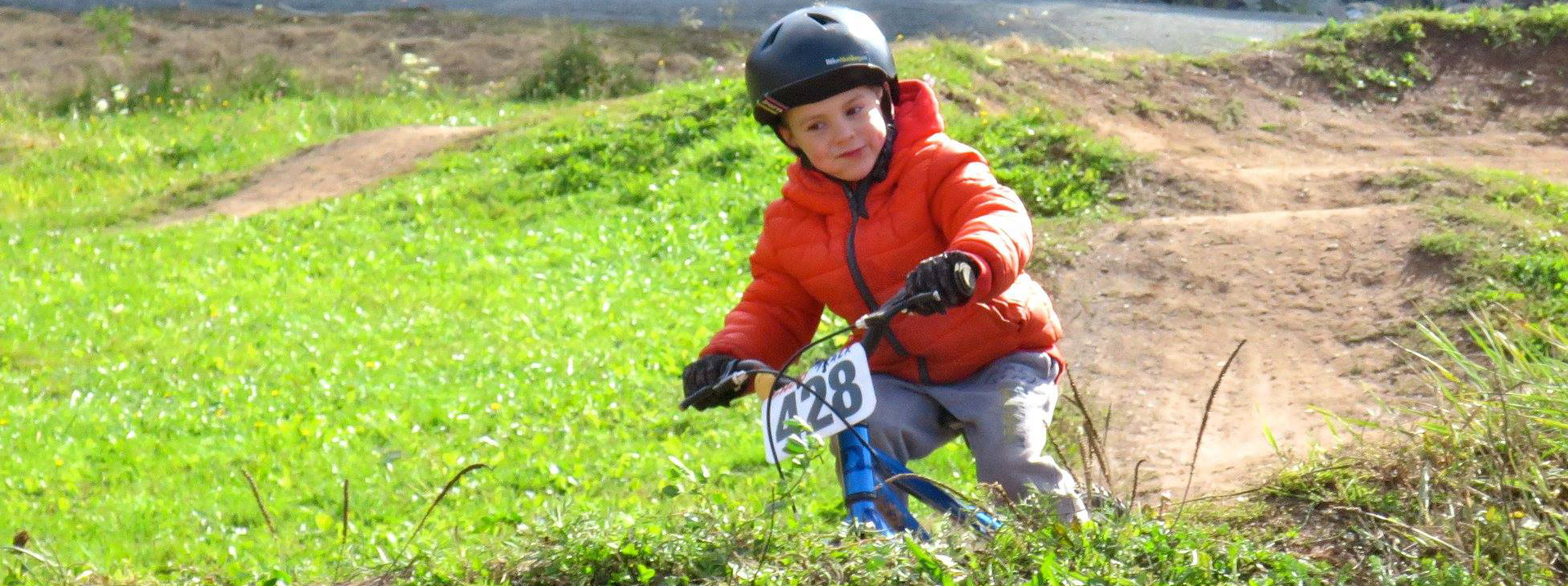 Youth rider on the pump track at Keppoch Mountain